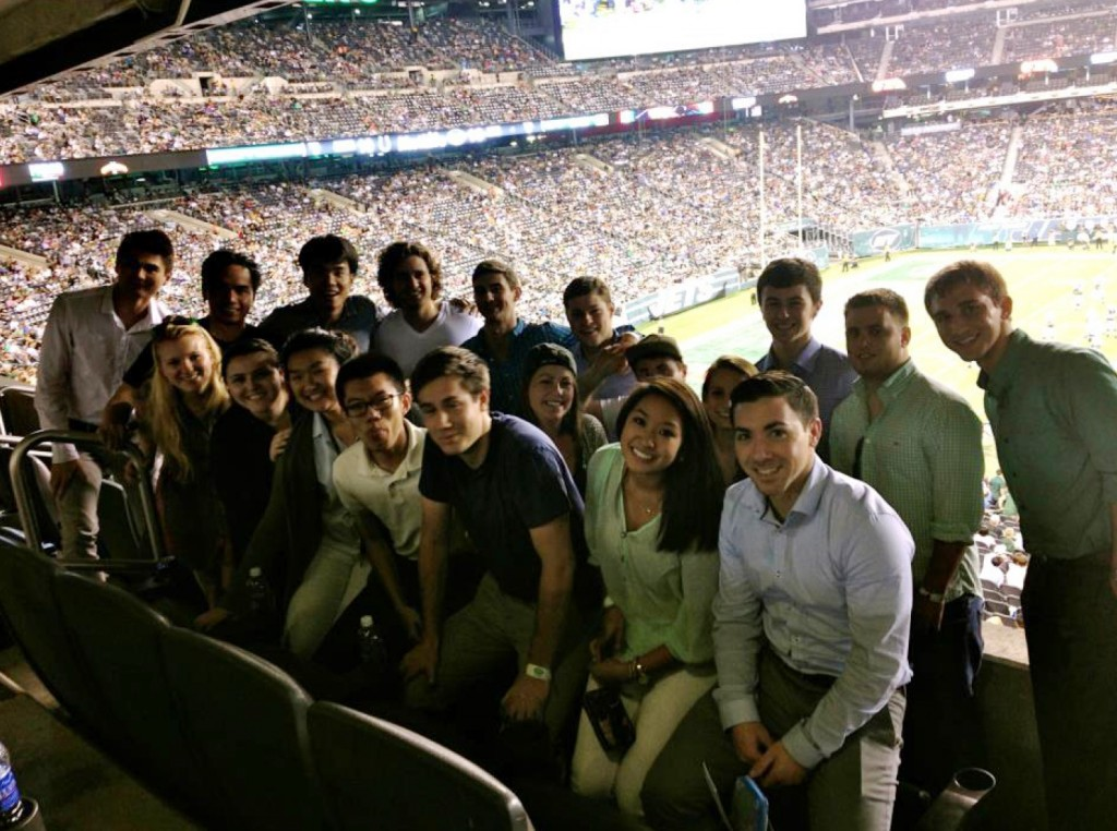 UTC College of Business graduate Lynna Nguyen and her fellow interns at a New York Jets game.