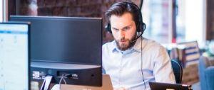 man providing customer service at his laptop