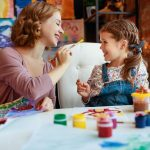 mom and daughter painting together