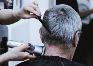 older gentleman getting a haircut