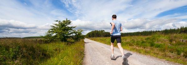 man running in open field