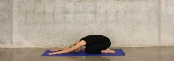 woman striking a yoga pose