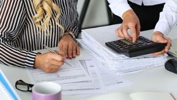 two bookkeepers working on paperwork