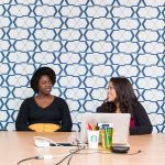 three woman having a meeting in an office