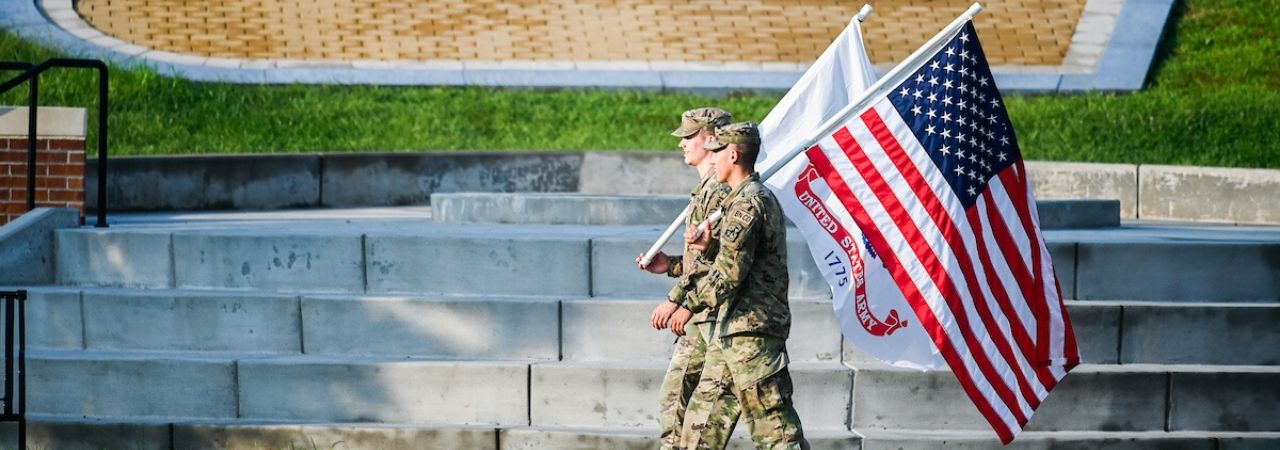 two soldiers carrying flags