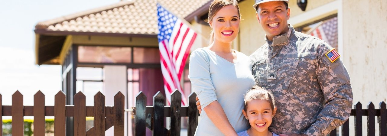 military family in front of a flag
