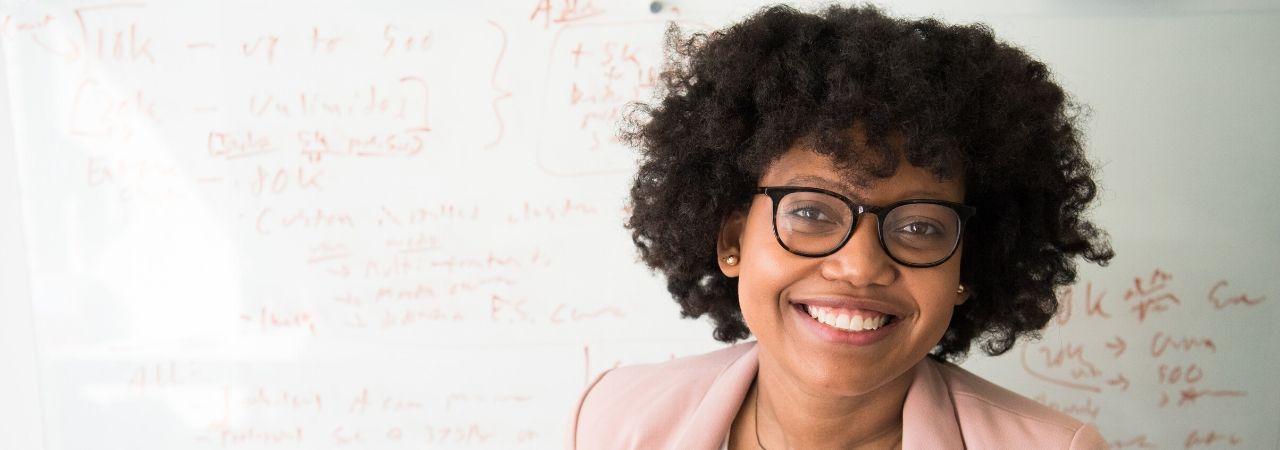 African-American female teacher at a whiteboard