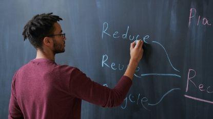 male teacher writing on a chalkboard