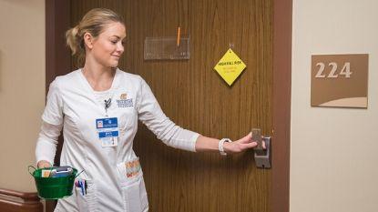 female nurse exiting a hospital room