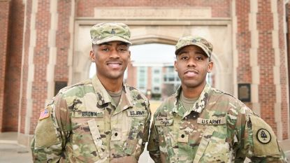 two military men in uniform looking at camera