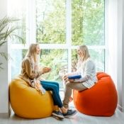 a female therapist having a session with a young woman while sitting on exercise balls