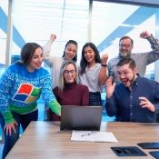 a group of coworkers cheering one of their team members on