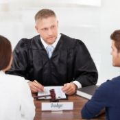 a judge meeting with a young couple