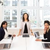 a woman leading a team meeting at an office