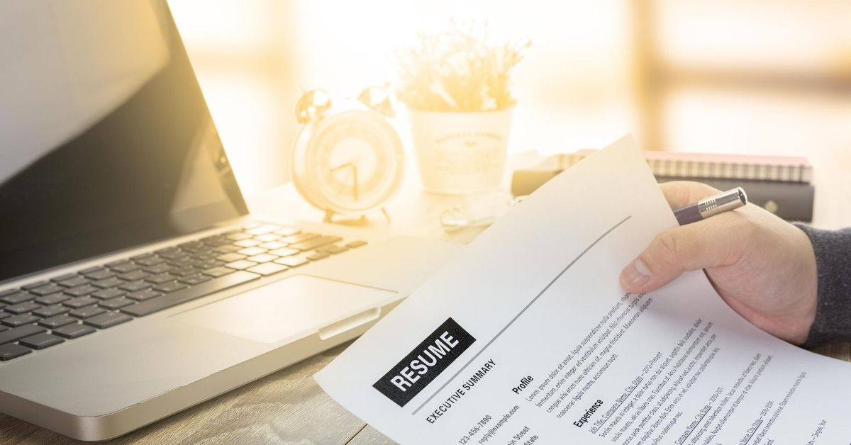 Man holding a resume