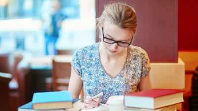 female student reading textbooks