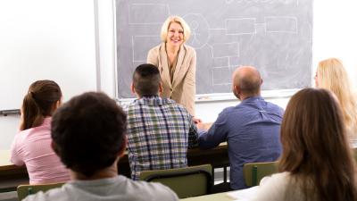 female teacher instructing adult students