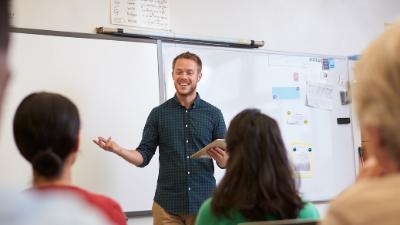male teacher instructing adult students