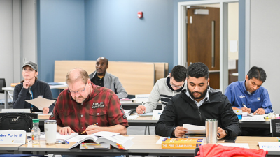 students preparing for pmp exam in a prep course