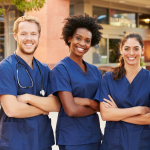 medical professionals in navy scrubs