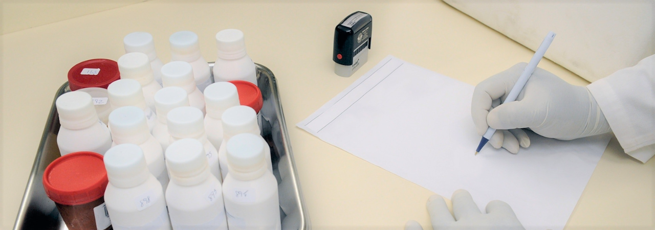 pharmacist writing prescription