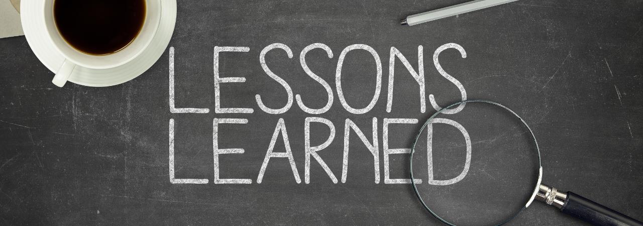 lessons learned written on chalkboard