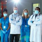 Team of medical professionals wearing masks