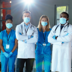 Team of medical professionals wearing masks