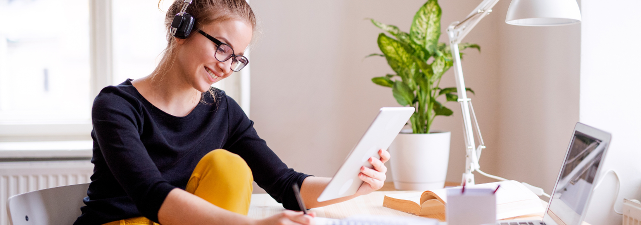 woman studying notes and working at computer