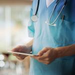 nurse holding an iPad
