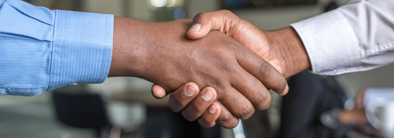 HR professionals exchanging a handshake