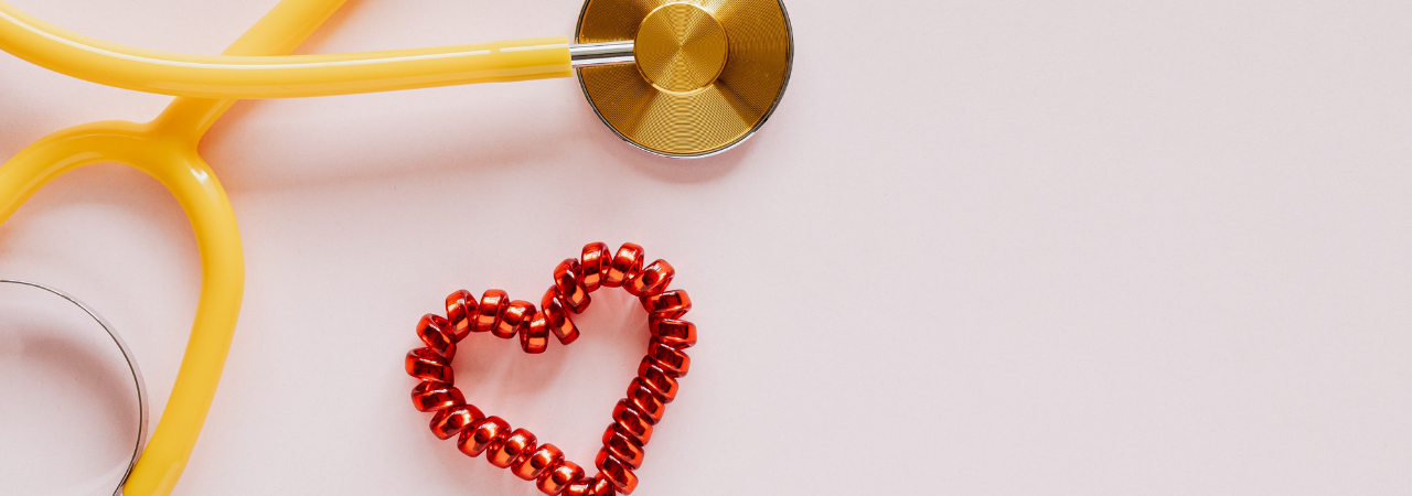 yellow stethoscope with heart beside it