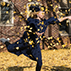 graduate celebrating in leaves