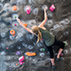Photo of student on climbing wall in the ARC
