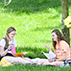 Photo of students hanging out on Chamberlain Field