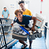 Photo of parent and student moving into residence hall