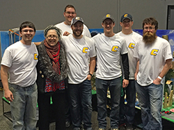 The team is pictured here with Rube Goldberg's granddaughter, Jennifer George