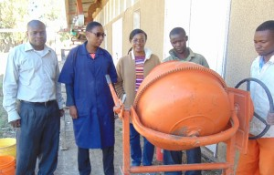 Research Team at Mbeya University of Science and Technology (MUST). From left to right Mr. Joseph Mnkeni and Ms. Shamsa Nassibu, Instructors at MUST; Dr. Mbaki Onyango Assistant Professor at UTC and Ayubu Daniel and Isaya Benard, helping with block making.