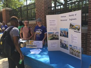 Members from the UTC American Society of Mechanical Engineers Student Chapter speak to new students
