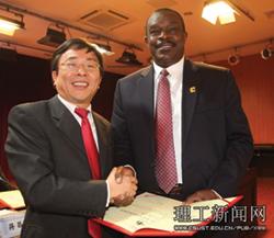 Dr. Joe Owino with Changsha Chancelor