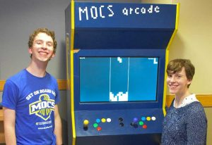 'Mocs'Phersons: Siblings Plugged into Video-Game Arcade