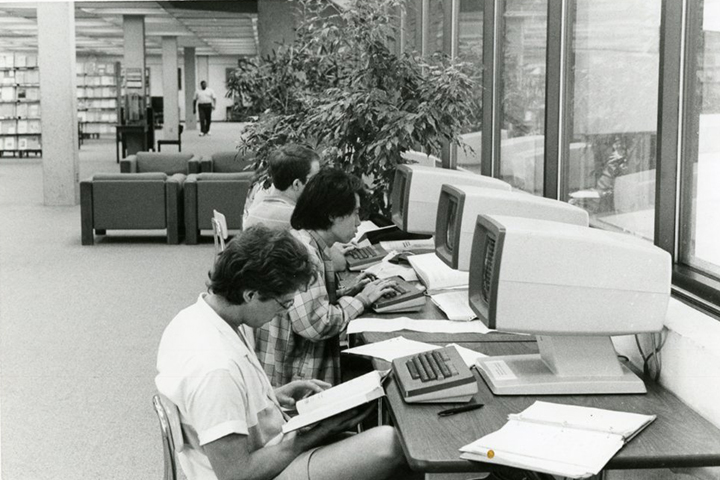 Student researchers make the transition from pen and paper to computers. Photo courtesy of Special Collections & University Archives, UTC Library, The University of Tennessee at Chattanooga.