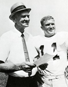 "Football Coach A.C. ""Scrappy"" Moore with Captain Larry Elmore"