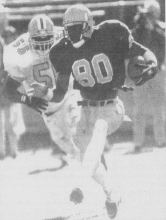 Owens running the ball during the 1995 season.