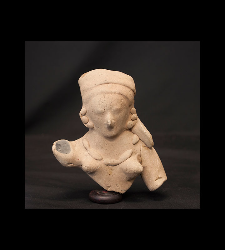 Pre-Columbian hollow ceramic bust of a woman with minimal facial features. Courtesy of the University of Tennessee at Chattanooga Special Collections.
