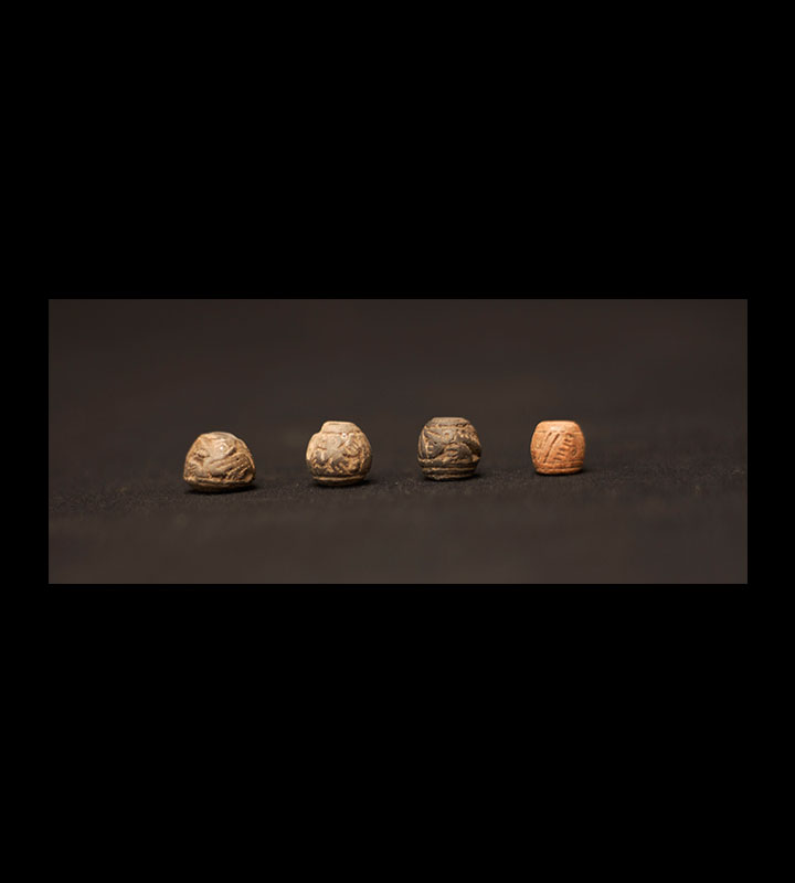 Pre-Columbian Manteno spindle whorls or beads with incised designs on them. Courtesy of the University of Tennessee at Chattanooga Special Collections.