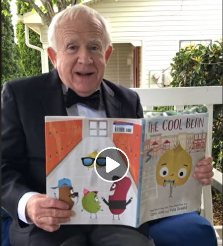 """Leslie Jordan sitting on a porch swing holding the book """"The Cool Bean"""""""