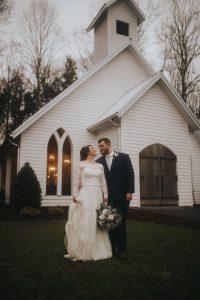 Newlyweds standing outside a chapel