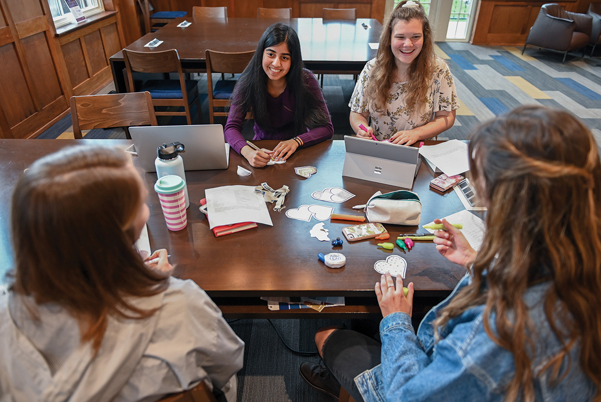 Shriya Purohit, Emily Hemingway, Jesse Hayes and Sydney Ellis, clockwise from left, talk Thursday, Feb.13, 2020 in Guerry Center.