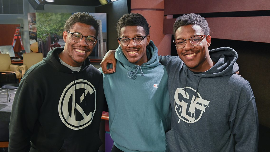 Triplets Chris, Chancey and Caleb Figures, from left, Friday, Feb. 4, 2021 in the Metro studio.
